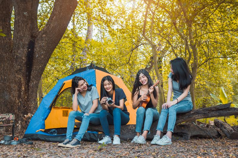 Friends Group of Young Asian women camping and resting stock photos