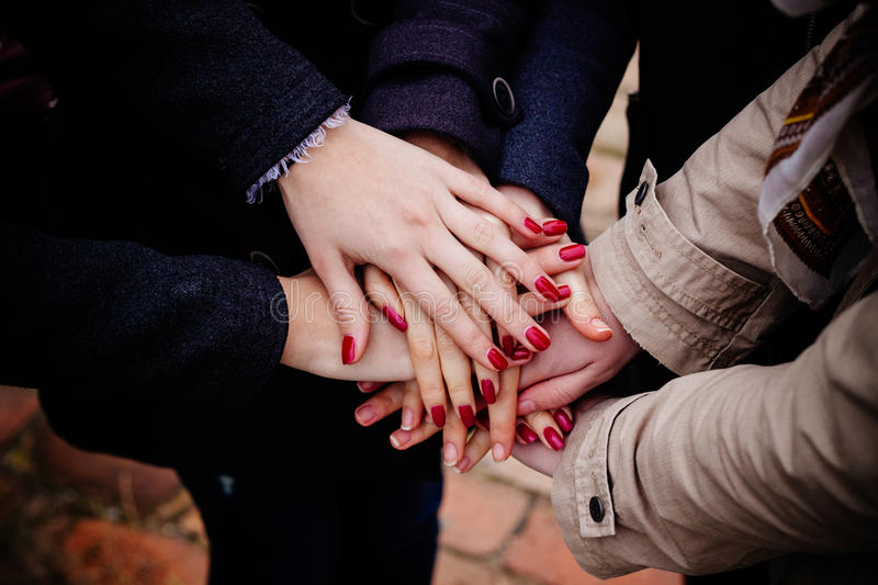 Friends with hands together, friendship royalty free stock photo