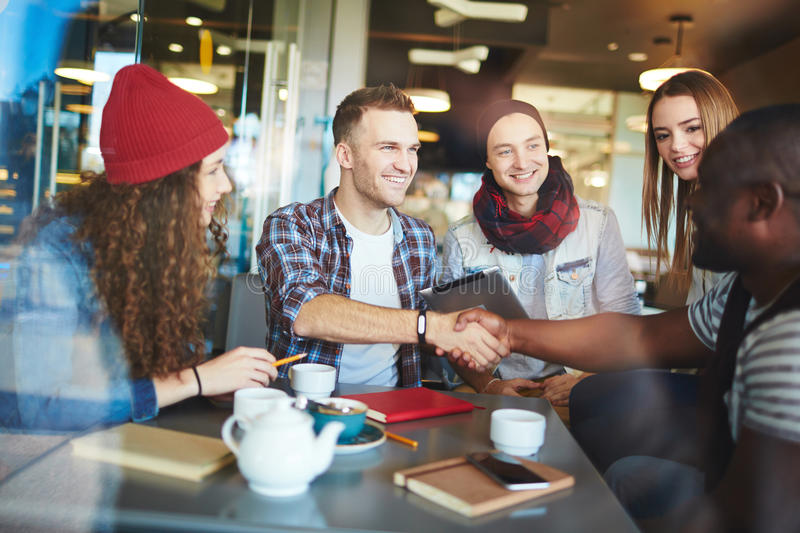 Friends handshaking royalty free stock images