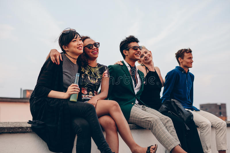 Friends hanging out together on rooftop royalty free stock photos