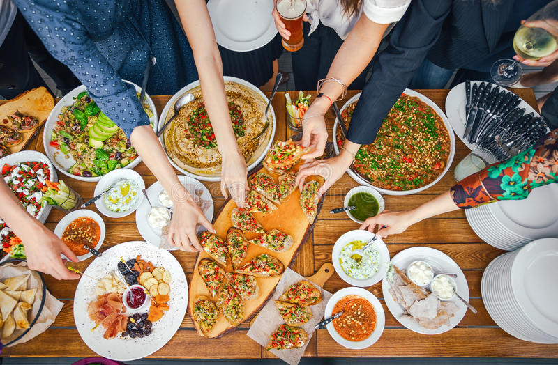 Friends Happiness Enjoying Dinning Eating Concept. Food Buffet. Catering Dining. Eating Party. Sharing Concept royalty free stock image