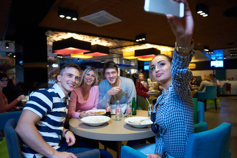 Friends have lanch break in shopping mall stock image
