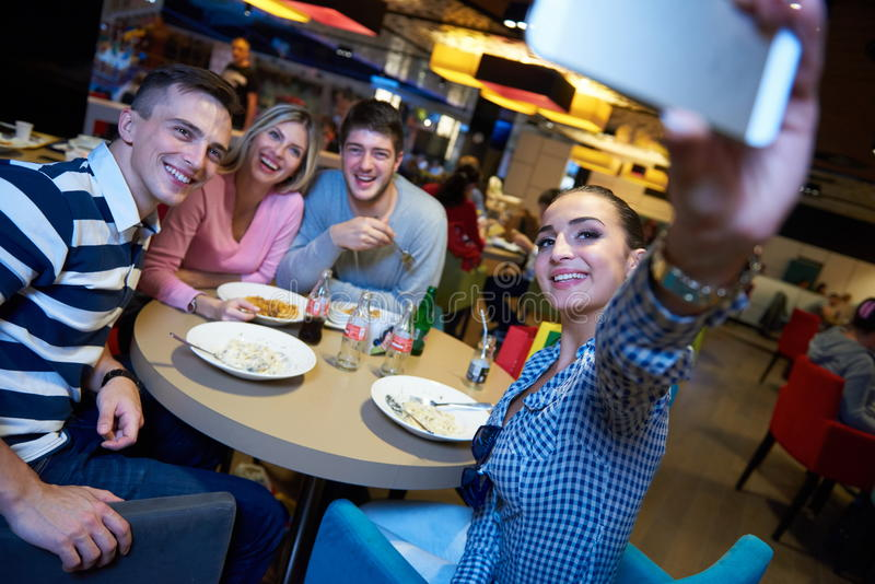 Friends have lanch break in shopping mall stock images