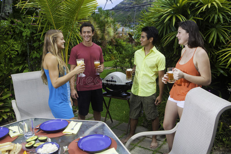 Friends having a barbecue party stock photography