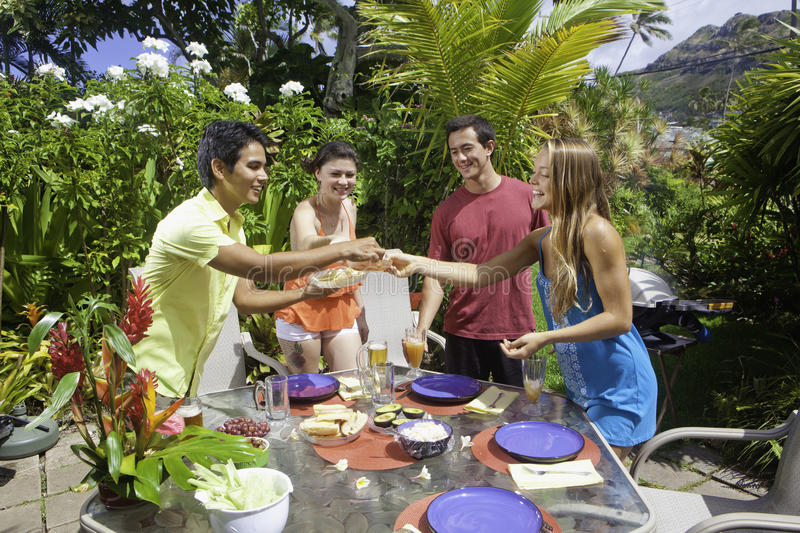 Friends having a barbecue party stock images