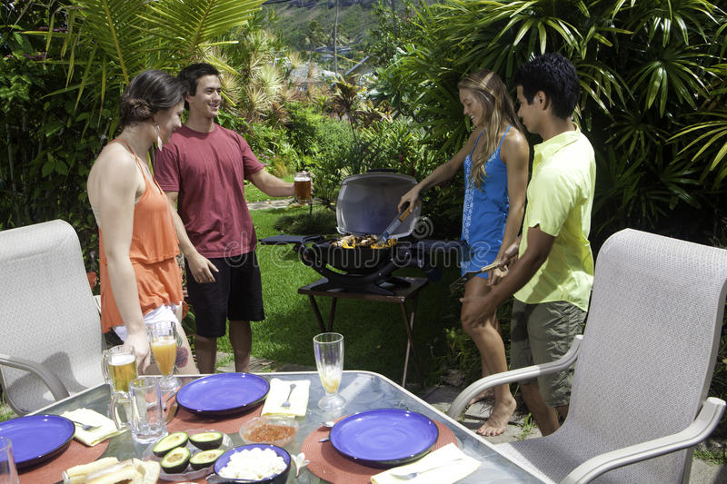 Friends having a barbecue party royalty free stock photo
