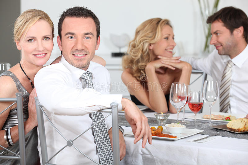 Friends having dinner. At home royalty free stock photography