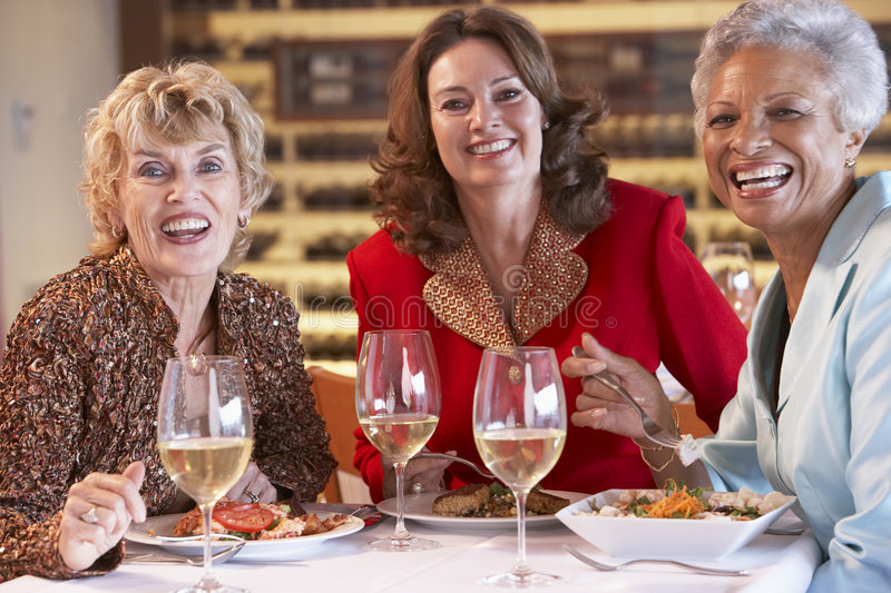 Friends Having Dinner Together At A Restaurant stock photo