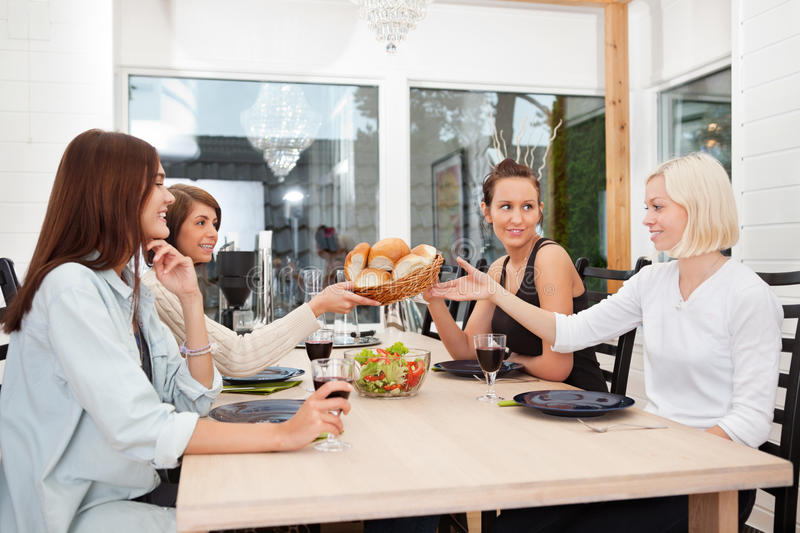Friends having food and drink at home royalty free stock photo