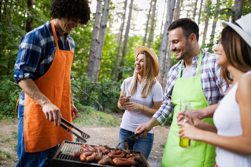 Group of friends having barbecue party in nature royalty free stock photography