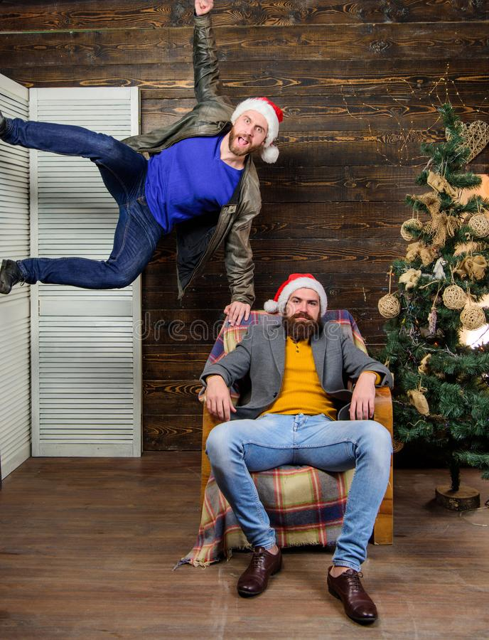 Friends having fun on christmas eve. Can not hold back emotions. Emotional coup. Cant wait. Change point of view. Waiting for christmas. Cheerful men having stock photos