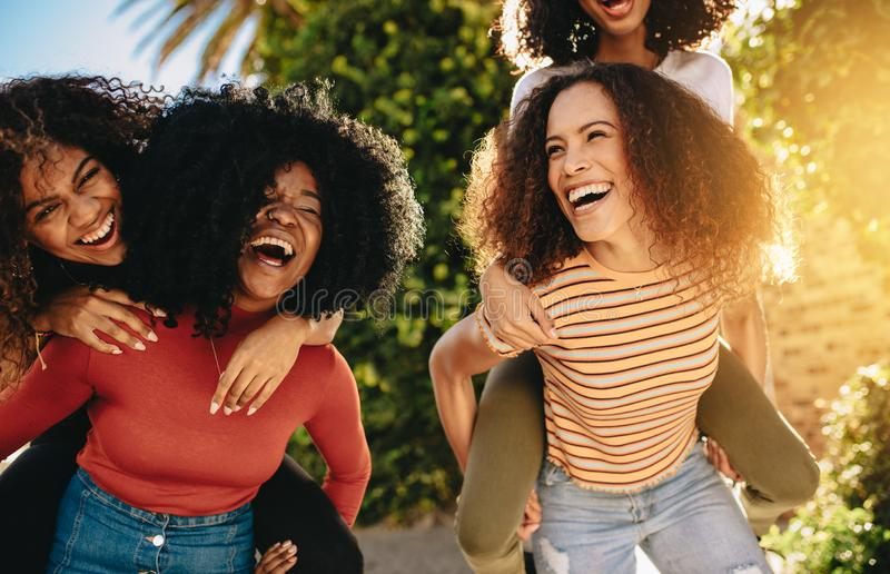 Friends having fun on day out stock images