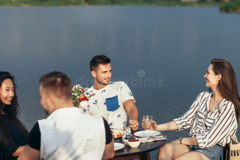 Friends having fun during the dinner in outdoor restaurant stock images