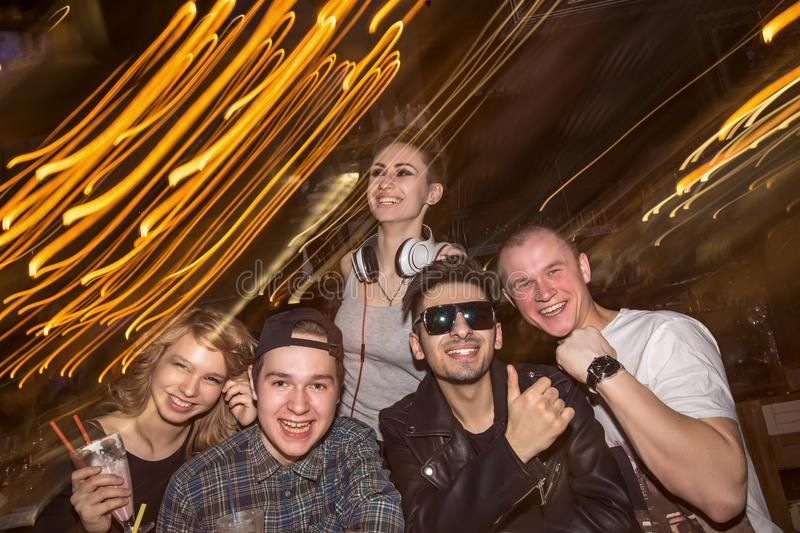 Friends having fun and drinking beer in night club. long exposure royalty free stock images