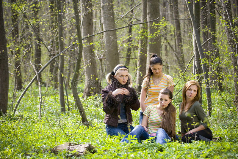 Friends having fun in the forest stock images