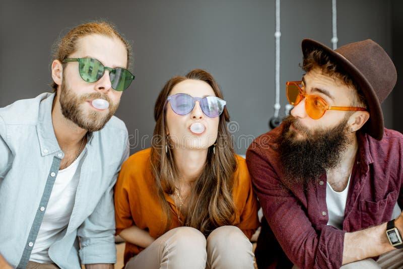 Friends having fun with gum bubbles stock photos