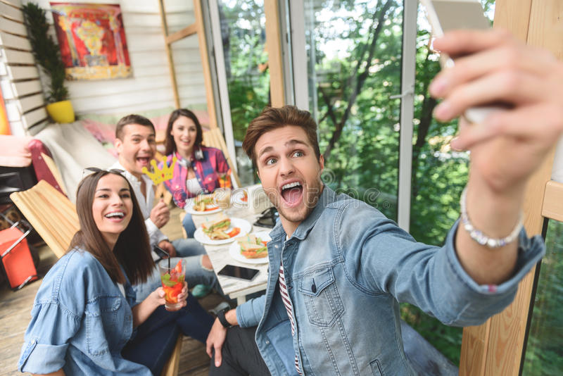 Friends having fun during lunch together royalty free stock image