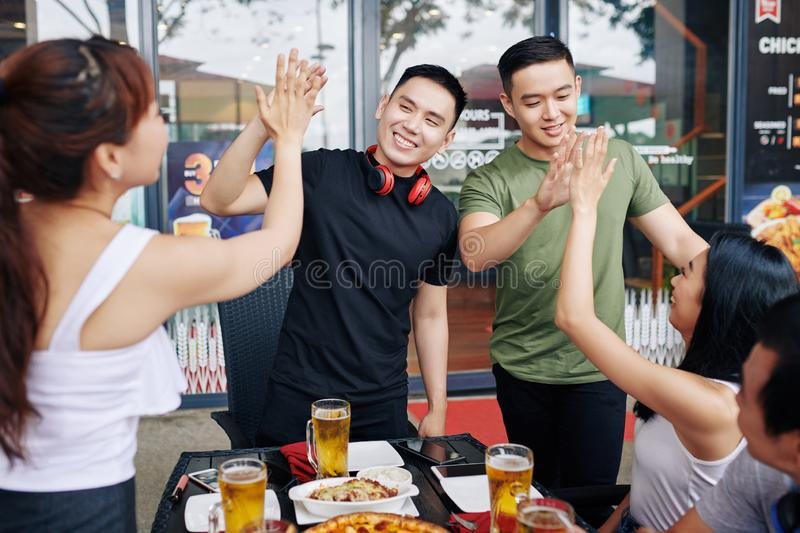 Friends having fun during meeting in cafe royalty free stock photography