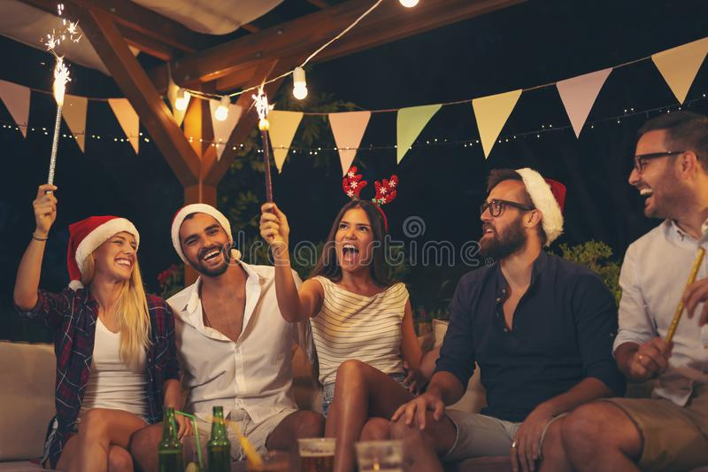 Friends at an outdoor New Year`s Eve party royalty free stock images