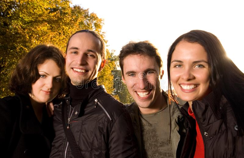 Friends having fun outdoors stock images