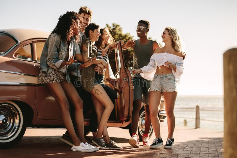 Friends having fun outdoors on road trip stock photo