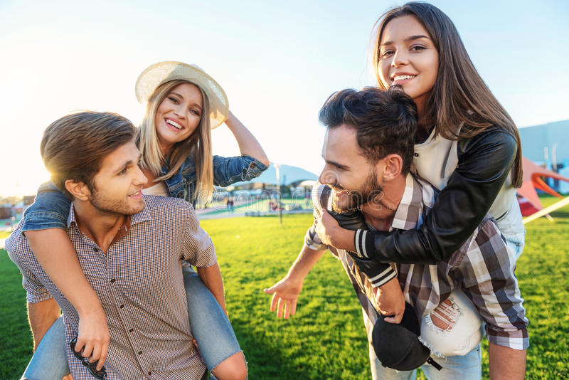 Friends having fun in the park royalty free stock photography