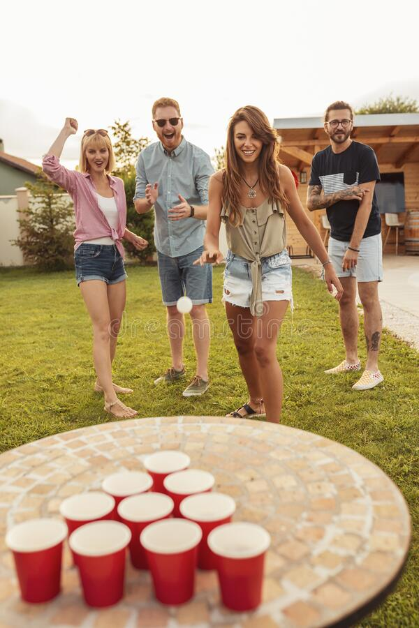 Free Friends Having Fun Playing Beer Pong Royalty Free Stock Image - 215360576