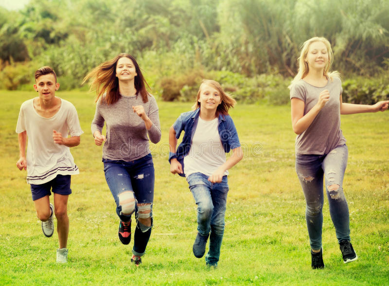 Friends having fun and running in park royalty free stock photography
