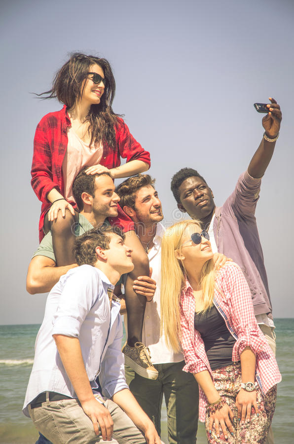 Friends having fun while taking a selfie royalty free stock photo