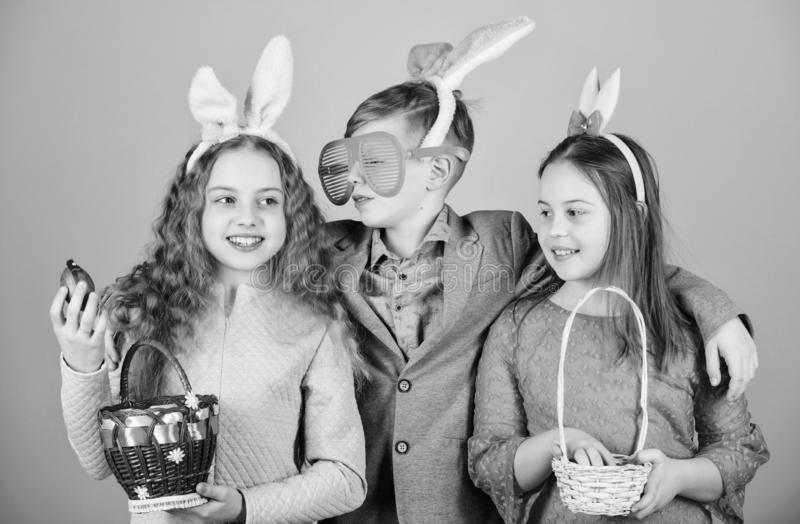 Friends having fun together on Easter day. Children with little basket ready hunting for Easter eggs. Ready for eggs. Hunt. Group kids bunny ears accessory stock photography