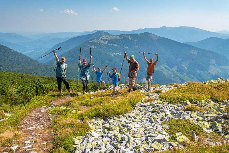 Friends having fun during a travel in mountains royalty free stock image