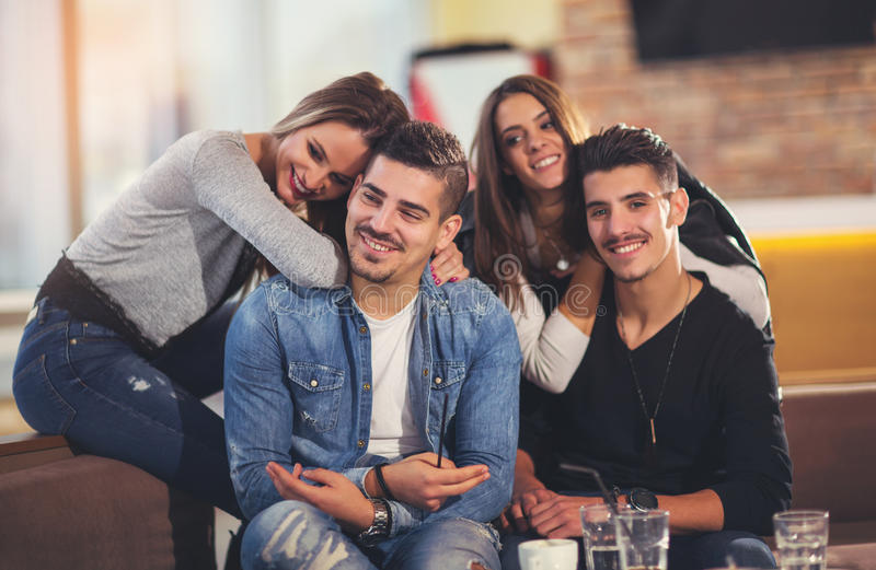 Friends having a great time in restaurant. Young friends having a great time in restaurant royalty free stock photo