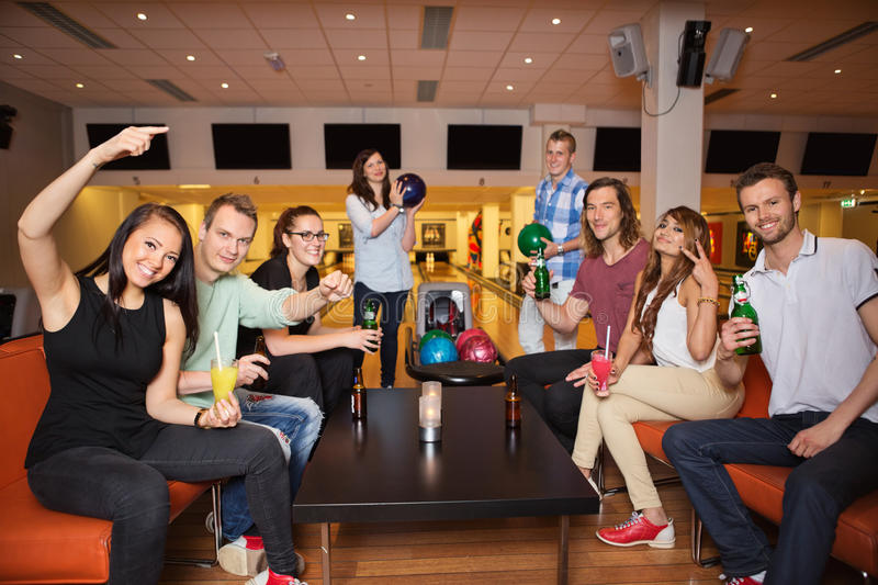 Friends Having Leisure Time in Bowling Club stock photo