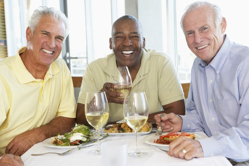 Friends Having Lunch At A Restaurant stock images