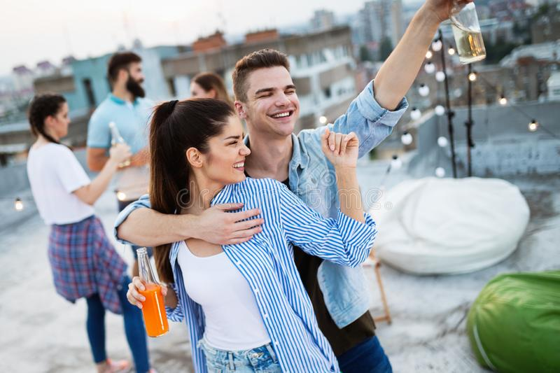 Friends having party on top of the roof. Fun, summer, city lifestyle and friendship concept royalty free stock photos
