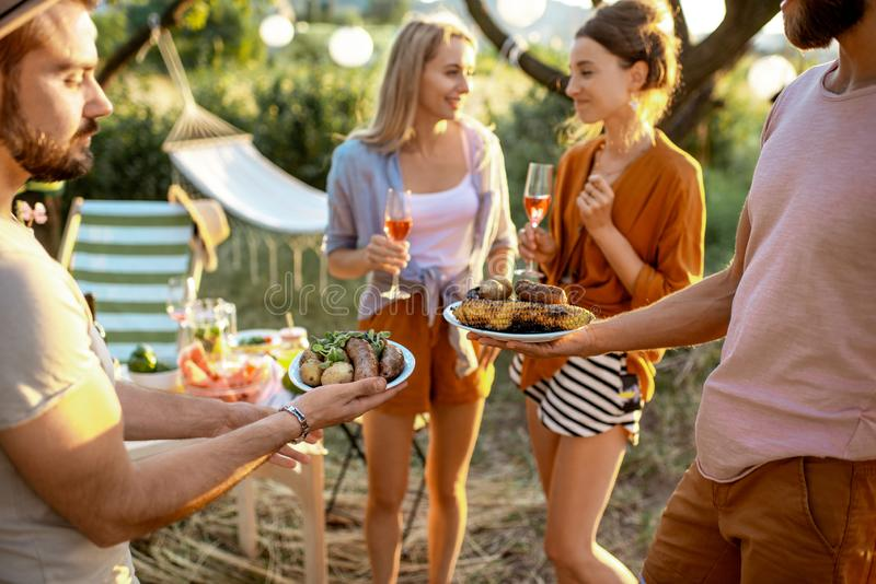 Friends having a picnic in the garden royalty free stock image