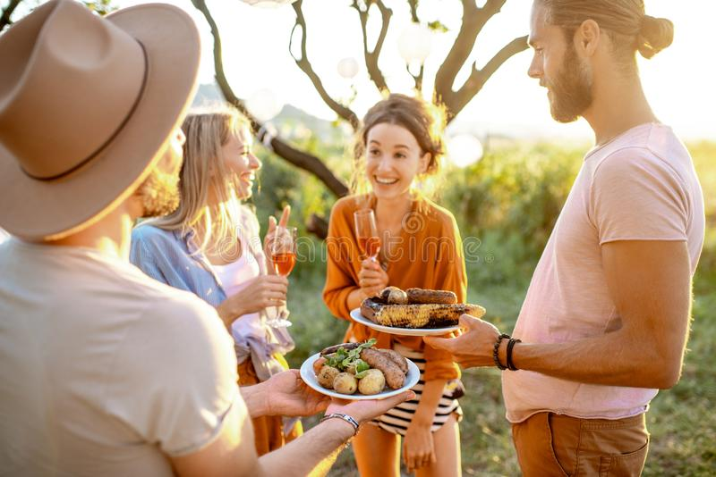Friends having a picnic in the garden royalty free stock photography