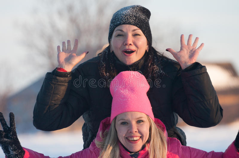 Friends having a selfie on the snow stock image