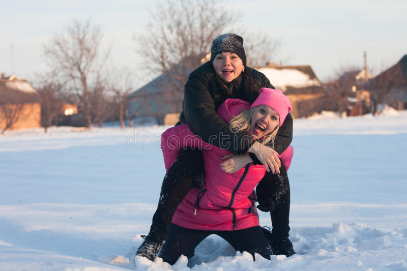 Friends having a selfie on the snow royalty free stock photos