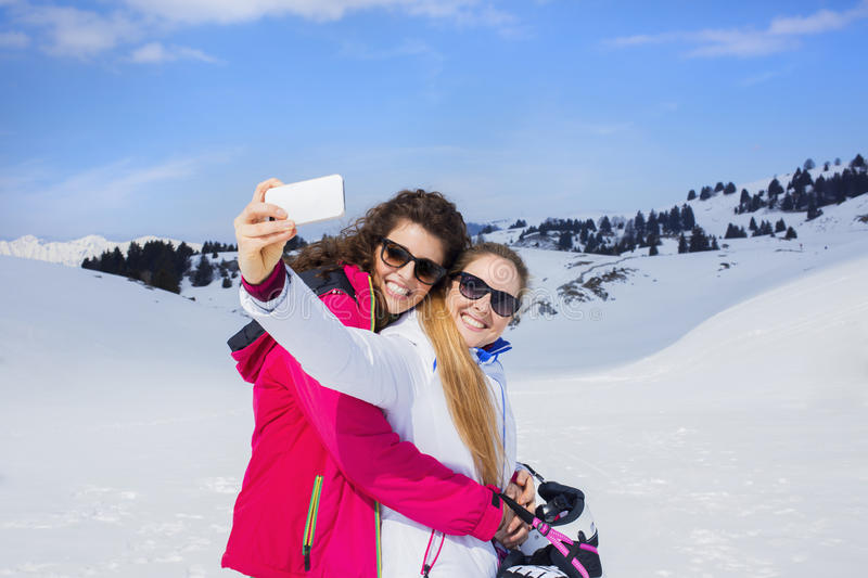 Friends having a selfie on the snow. In mountain stock photography