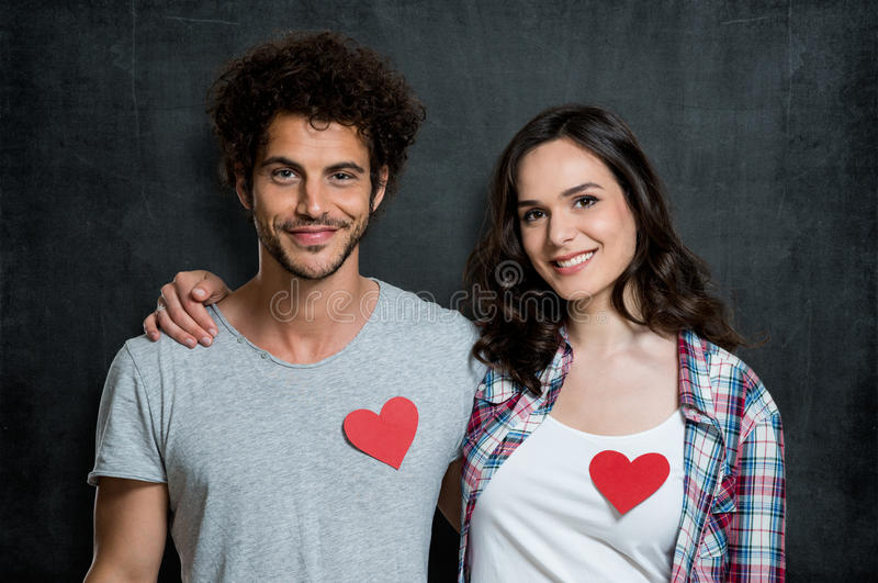 Friends Of The Heart. Young Happy Couple With Red Heart Shape stock images