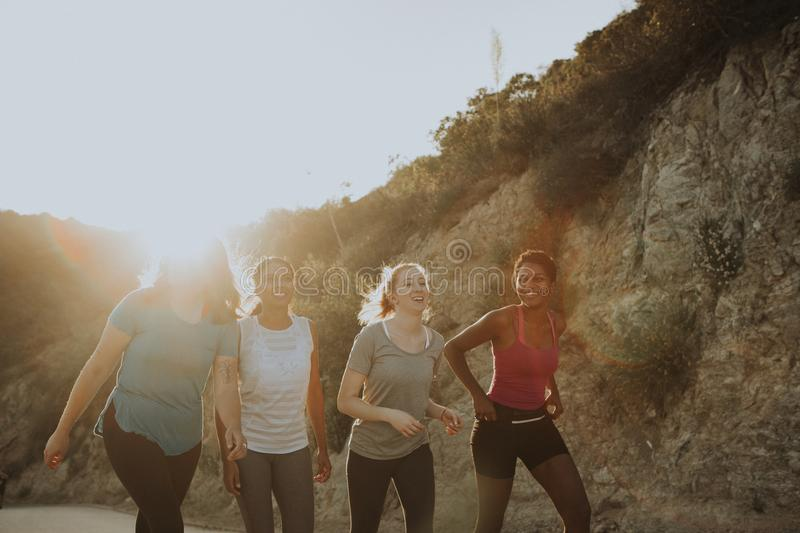 Friends hiking through the hills of Los Angeles royalty free stock image