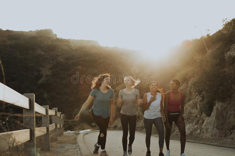 Friends hiking through the hills of Los Angeles stock photography