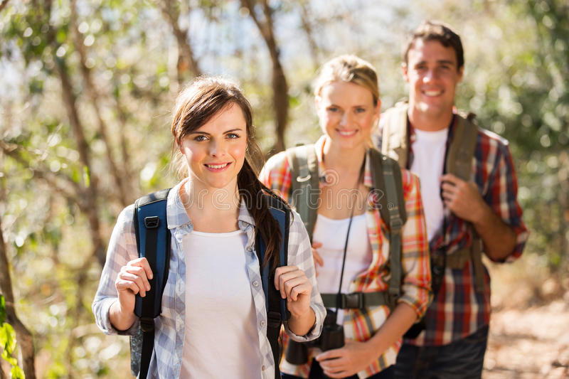 Friends hiking mountain. Group of happy friends hiking in autumn mountain royalty free stock photo