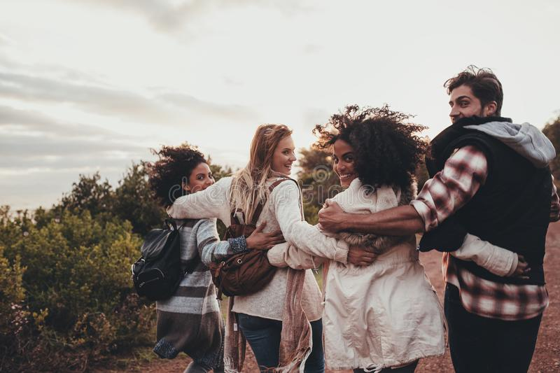 Group of friends hiking on a holiday stock photos