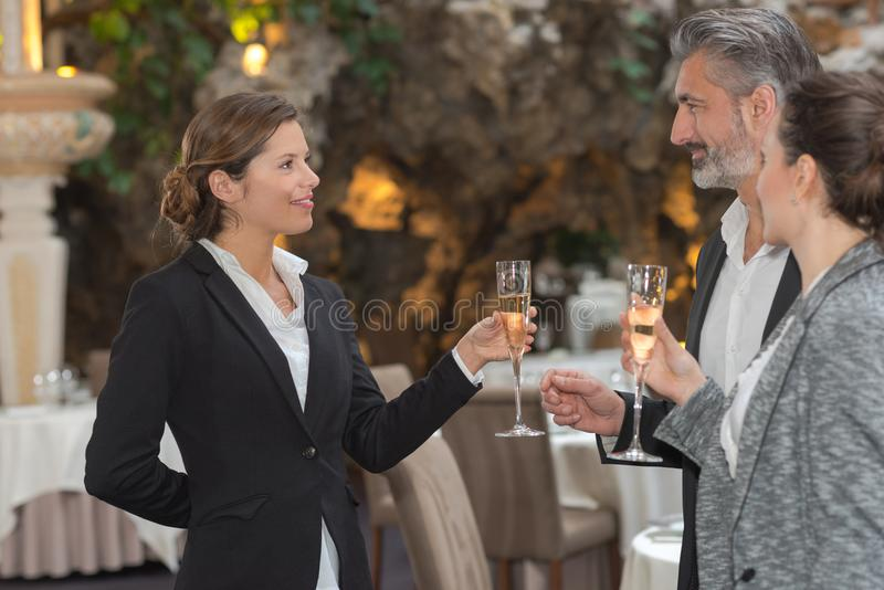 Friends holding glasses champagne making toast royalty free stock photo