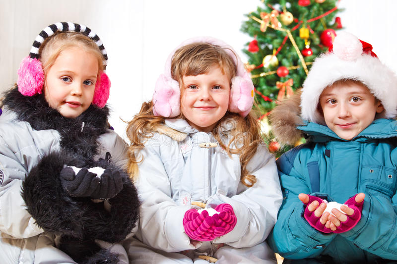 Friends Holding Snow In Hands Royalty Free Stock Photography