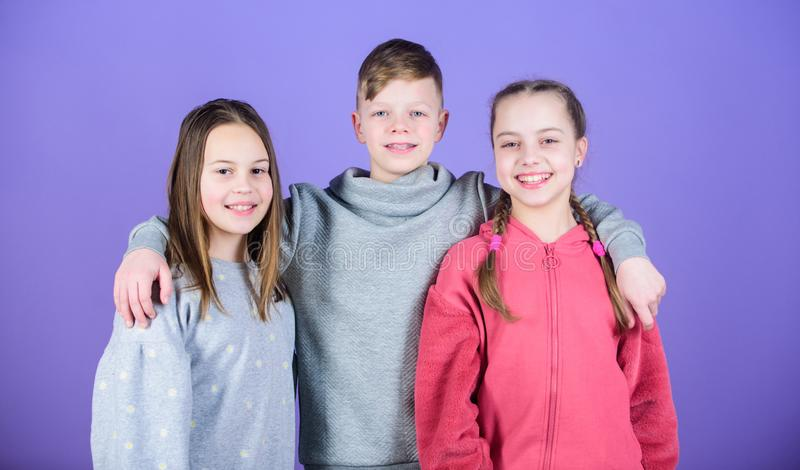 Friends hug. Childrens day. Cheerful youth. Relations and friendship. Happy to have such good friends. Teens friends. Girl and boy true friendship. Children royalty free stock image