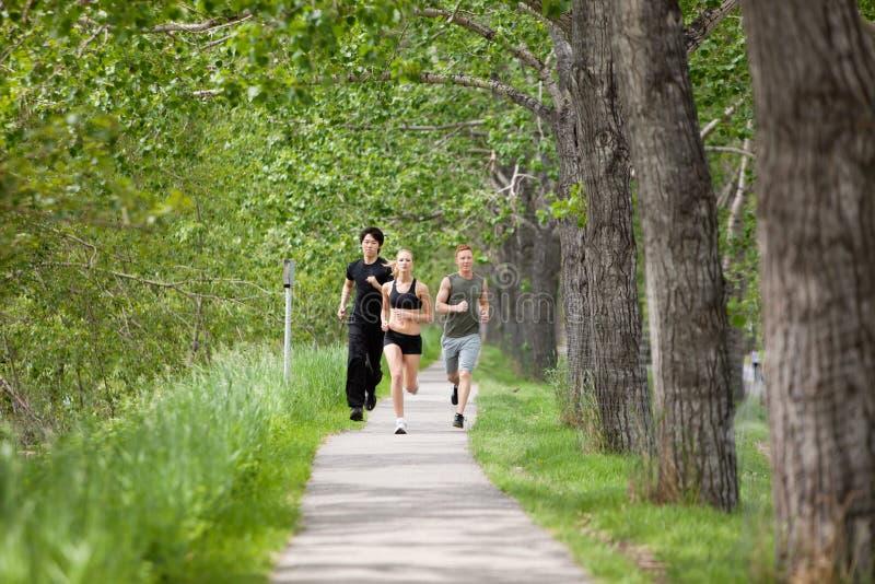 Friends jogging stock images