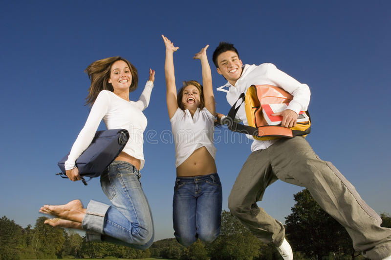Friends jumping in the air. stock images